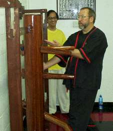 Photo - Sifu Mike Adams receives advanced Wing Tsun (Wing Chun, Ving Tsun) Kung Fu training on the wooden dummy from Grandmaster Leung Ting