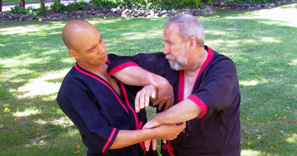 Master Mike Adams executes a devastating WingTsun Pie-Jarn elbow attack against Sifu Claudio Mascarenhas.