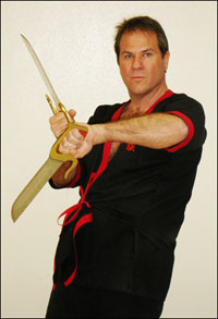 Master Will Parker demonstrates a WingTsun Bart Cham Dao (8-Cutting Broadswords) technique