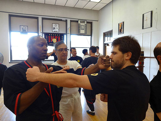 Sihing Darrell Taylor, left, of Authentic Wing Tsun of Peoria, training with Great Grandmaster Leung Ting