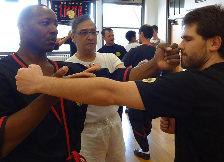 Great Grandmaster Leung Ting teaching authentic Wing Tsun kung fu during a visit to Dynamic Martial Arts of Bloomington-Normal