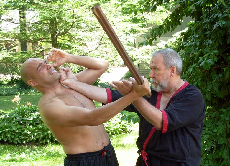 Master Mike Adams defends himself against an armed attacker using a WingTsun tan-da technique.